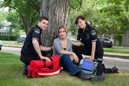 Emergency medical team treating a patient on the street Stock Photo - 10762605