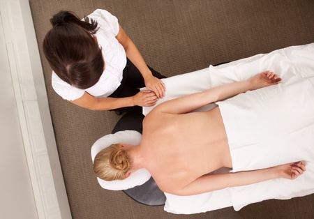 Female acupuncturist in clinic with a patient ready for therapy photo