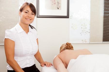 Portrait of a female acupuncturist with patient photo