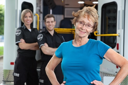 cfr: Portrait of elderly patient with ambulance workers in background Stock Photo