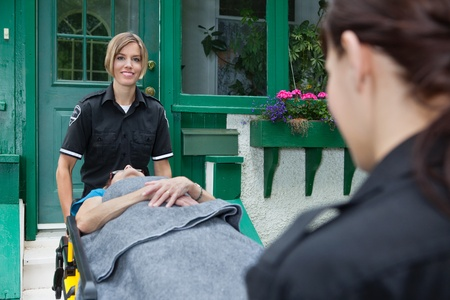 Smiling emergency with patient on stretcher Stock Photo - 10789813