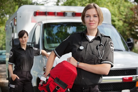 EMS professional with portable oxygen equipment Stock Photo