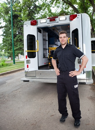 ems: Happy ambulance driver standing for a portrait outdoors