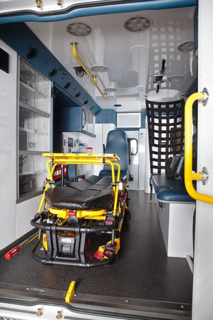 emergency cart: Detail of an empty ambulance interior with stretcher