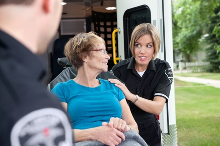 cfr: Lifestyle shot of an ambulance worker asking a patient a question