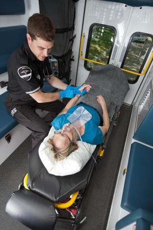 Ambulance professional with senior woman on stretcher Stock Photo - 10836654