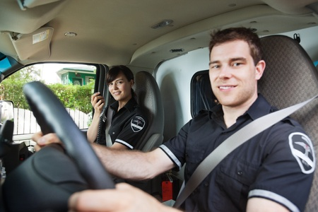 paramedic: Portrait of man and woman paramedic team, shallow DOF critical focus on female