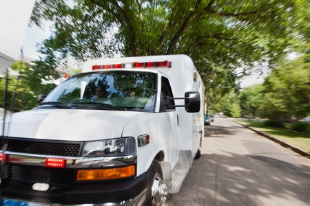 respond: Ambulance vehicle travelling to accident, motion blur to give sense of speed Stock Photo