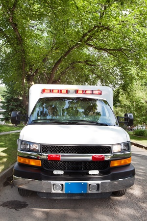 cfr: Ambulance on street in residential urban area