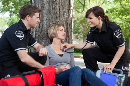 Emergency medical professionals with a good assessment of a patient Stock Photo