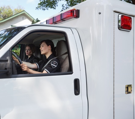 cfr: Two female ambulance professionals in a vehcile
