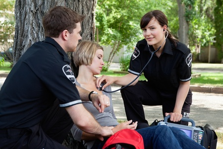 Emergency medical professionals assessing an injured patient photo