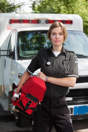 Portrait of an EMS professional carrying a protable oxygen unit photo