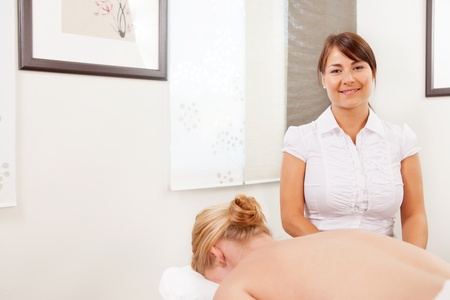 acupuncturist: Portrait of a professional acupuncturist posing with patient ready for treatment Stock Photo