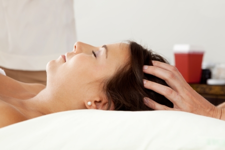 Young attractive woman receiving head massage Stock Photo - 10989192