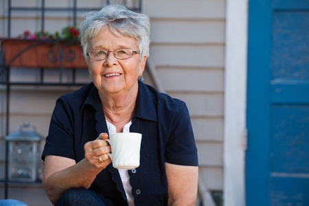 Lovely senior woman having a cup of tea Stock Photo - 11048303
