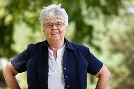 Portrait of confident elderly woman in park Stock Photo - 11048254