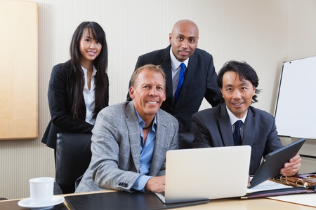 Portrait of multi ethnic businesspeople in office photo