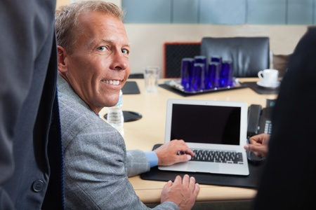 Portrait of mature man using laptop in office Stock Photo - 11048309