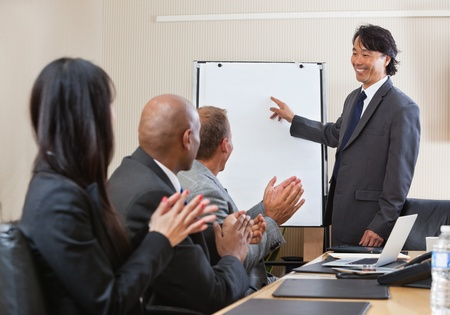 People giving applause after speech of a businessman at the conference Stock Photo - 11048288