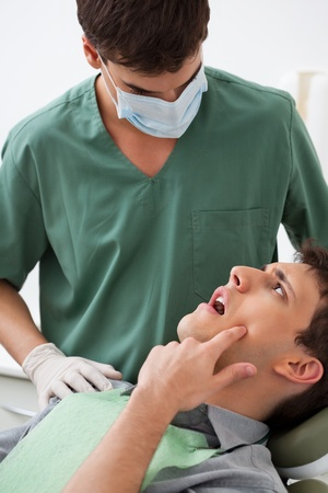 toothache: Patient showing tooth problem to the dentist