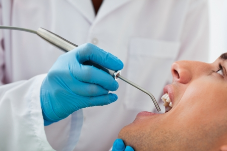 Dentist working on patient at clinic photo