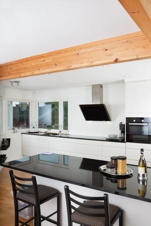 Luxury kitchen in a new modern home photo