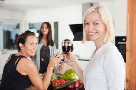 Female friends having a casual party at home photo