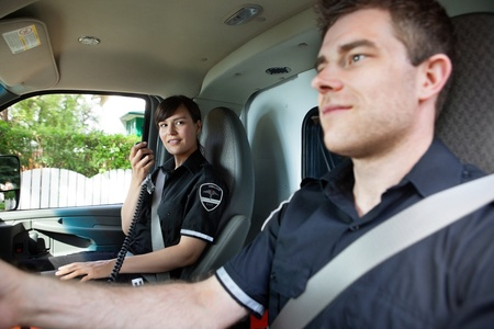 cfr: Paramedic team in an ambulance interior driving to destination Stock Photo