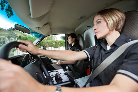 cfr: Two female paramedics driving to location of accident Stock Photo