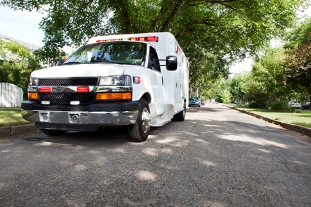 cfr: 34 view of an ambulance parked in a residential area of a city Stock Photo