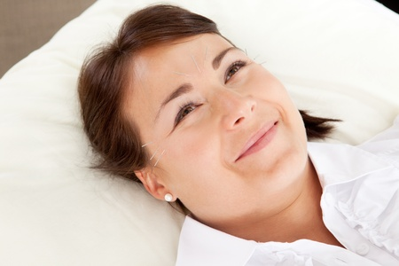 Acupuncture patient smiling and looking up photo