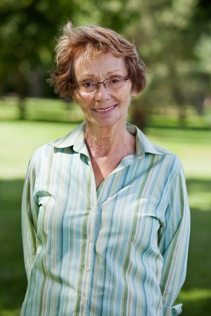 Close-up portrait of happy senior woman standing in park Stock Photo - 11048129