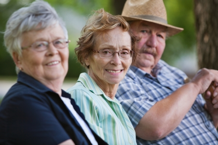 citizen: Portrait of senior friends sitting together in park