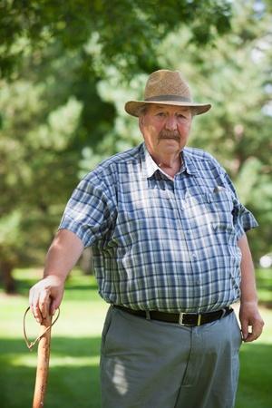 Portrait of senior man standing in park Stock Photo - 11048135