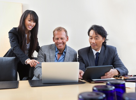 Group of diverse colleagues working on laptop Stock Photo - 11048151