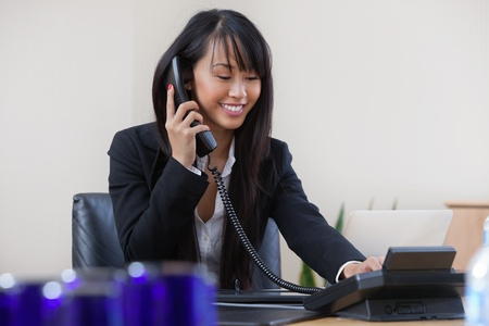 Young smiling business woman talking on phone photo
