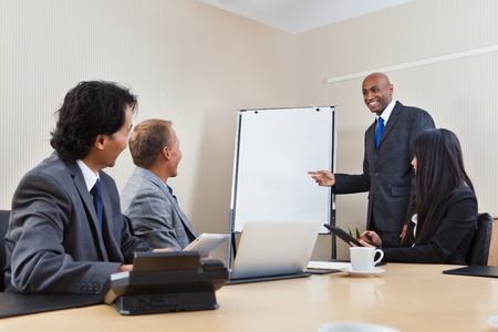 presentation board: An African American business man giving a presentation to associates