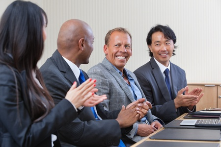 Professionals applauding during a business meeting photo