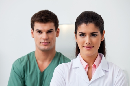 Portrait of female dentist standing with her assistant Stock Photo - 11173398