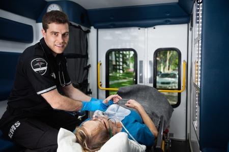 Portrait of a male EMT inside ambulance with senior woman patient Stock Photo - 11173337