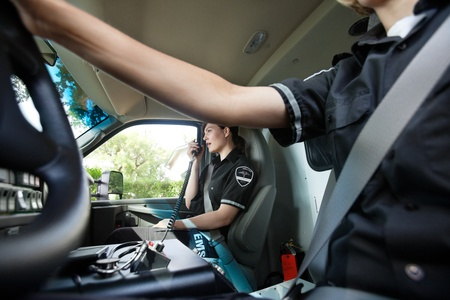 cfr: Abstract ambulance interior with female paramedic talking on radio with dispatcher