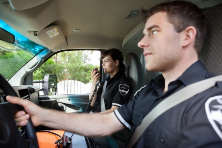 dispatcher: Paramedic talking on radio to dispatcher.  Shallow DOF critical focus on woman with handset