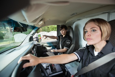 Two female EMS professionals driving to location photo