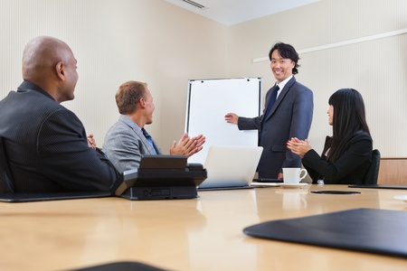 Smiling business man giving a presentation to associates photo