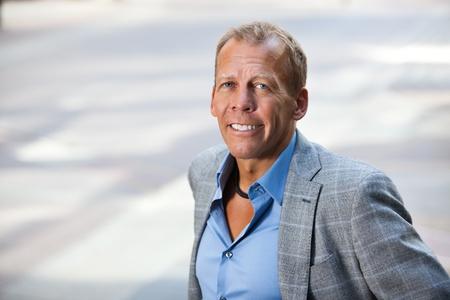 Close-up portrait of smiling businessman photo