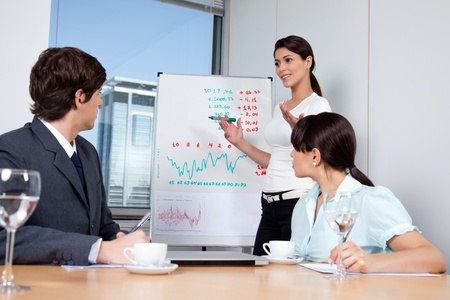 Business woman giving presentation to colleagues during meeting at office Stock Photo - 11538578