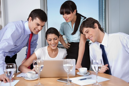 business dinner: Business woman with her team working on laptop