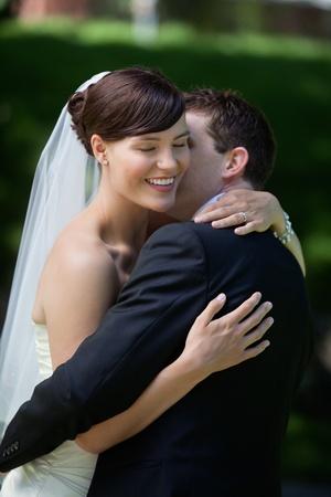 passionately: Groom passionately kissing brides cheek Stock Photo