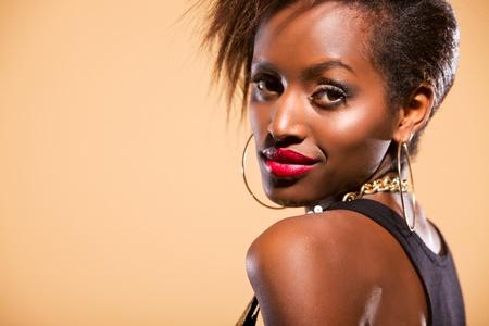 earing: Attractive model in studio looking over shoulder at camera